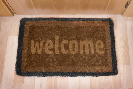 mat: Welcome home on brown mat