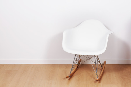 'rocking chair': Modern rocking chair inside an apartment