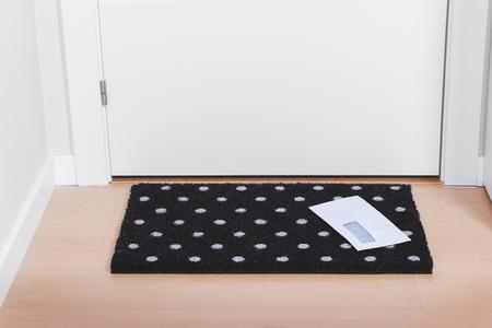 Welcome home doormat with envelope