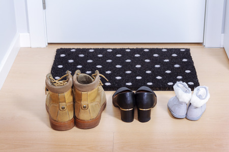 shoe print: Welcome home doormat with shoes Stock Photo