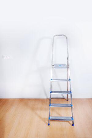 Aluminum ladder in interior room photo