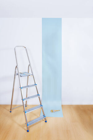 Aluminum ladder in interior room with roll paper photo