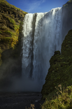 skogafoss waterfall: Skogafoss waterfall in Iceland with blue sky Stock Photo