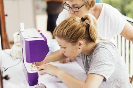 sewing machines: Young woman sewing a handbag