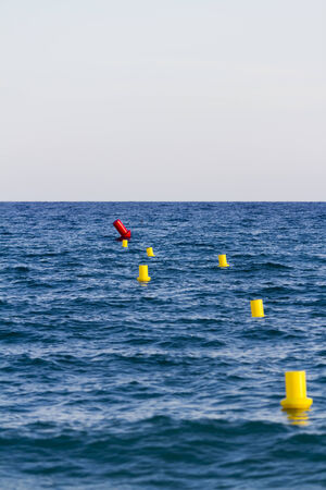 buoys: Yellow buoys in the sea
