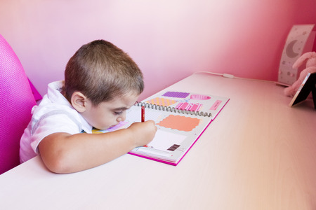 Little boy studying at home photo