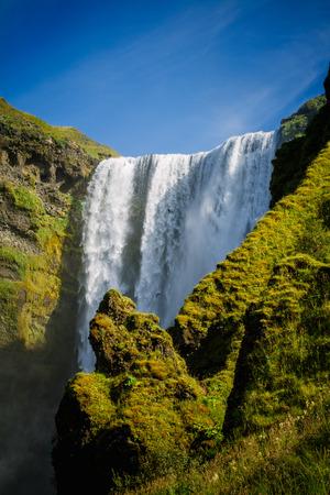 skogafoss waterfall: Skogafoss waterfall in Iceland with rocks