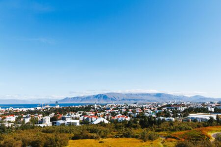 scandinavian landscape: Aerial view of Reykjavik, Iceland with harbor and skyline mountains