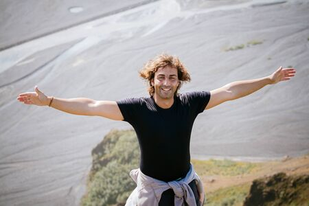 Freedom man in nature on iceland happy with arms enjoying free happiness