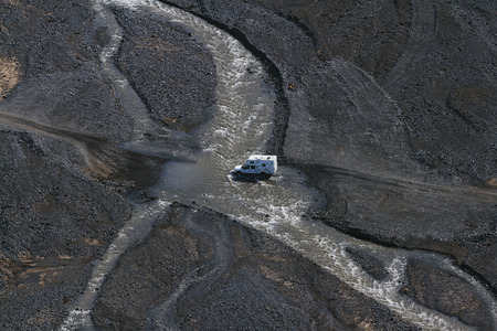 4wd: View of 4WD car wades river in Landmannalaugar, South Iceland