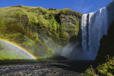 Skogafoss waterfall in Iceland with rainbow photo