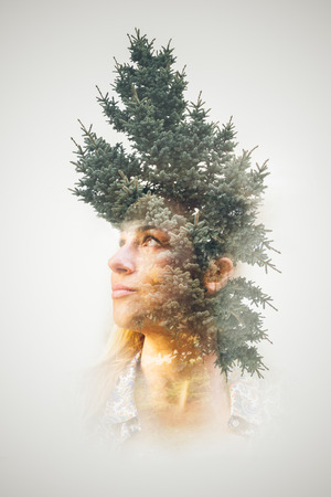 Double exposure of young girl using natural elements
