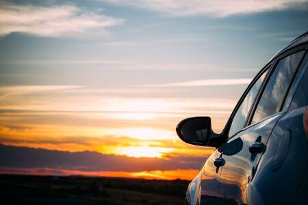 purple sunset: Rear view mirror at sunset Stock Photo