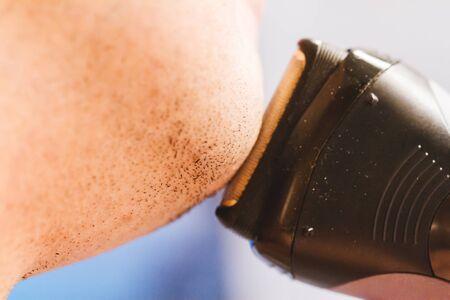 electric razor: Closeup of man shaving