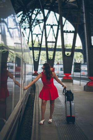 Red woman taking the train Stock Photo