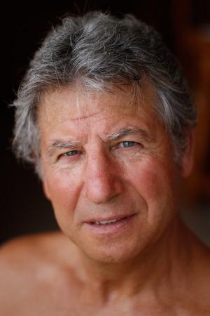 Senior man portrait with blur background