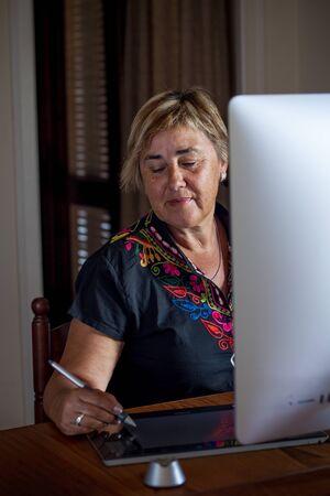 Portrait senior woman on workplace