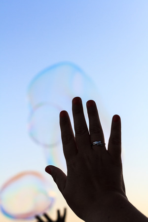 Bubbles and hand Stock Photo