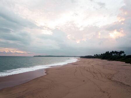 sunset near the ocean, pink sand Foto de archivo
