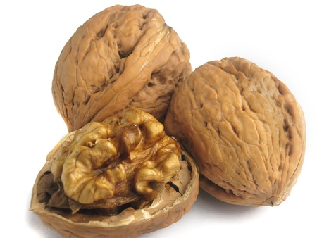 Three walnuts on a white backgroubd                                Stock Photo