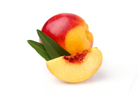 With a slice of peach and leaves isolated on a white background Stock Photo - 17750760