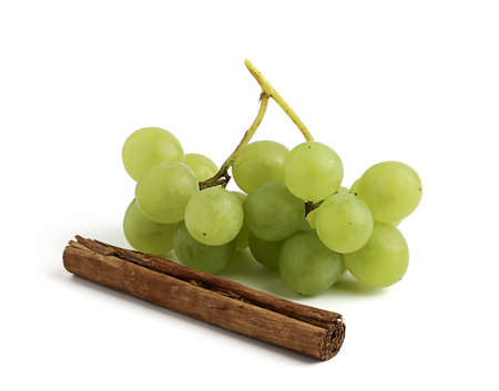 isoleted: Fresh grapes and cinnamon stick,isoleted on white background.