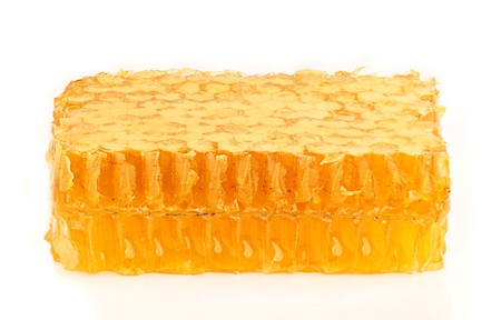 Honey in the comb close-up,isoleted on white background.