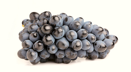 Black grapes, bunch close-up,isolated on white background.