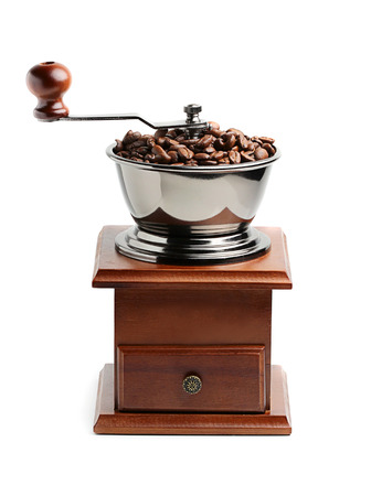 Coffee grinder with coffee beans isolated on white background.