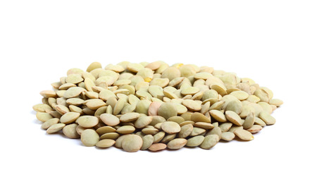Dry lentil isolated on a white background. photo
