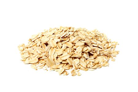 Heap of oat flakes isolated on white background.