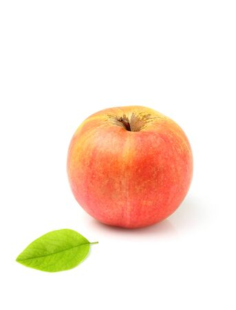 Ripe apple with leaf isolated on white background. Stock Photo