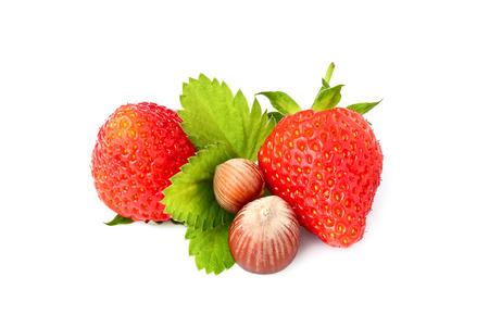 Strawberry with hazelnuts isolated on white background closeup.
