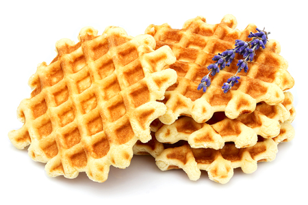lavender coloured: Round Belgian waffles with lavender isolated on white background. Stock Photo