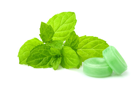 Peppermint candy with sprig mint isolated on white background.