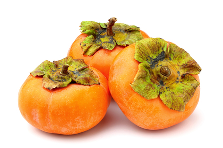 Ripe persimmons isolated on white background close-up. Stock Photo