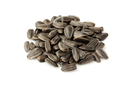 Sunflower seeds pile isolated on wite background.