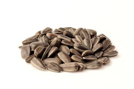 Sunflower seeds isolated on white background. Stock Photo