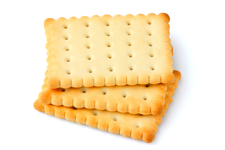 Fresh crackers; biscuit isolated close up on white background.