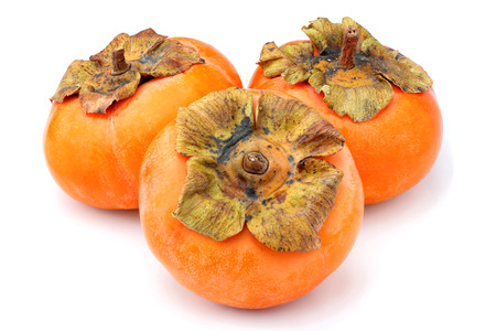 Fresh persimmons close-up on white background.