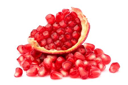 Part pomegranate fruit isolated on white background cutout.