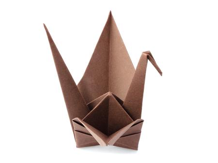 Origami crane isolated on white background.Origami bird close-up. Stock Photo