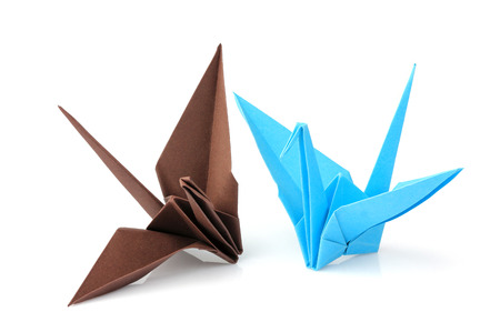Two origami cranes isolated on white background. Stock Photo
