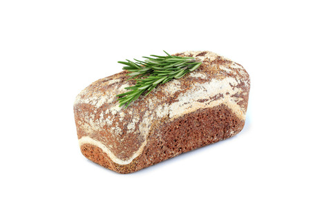 Homemade bread with a sprig of rosemary.Isolated on a white background.