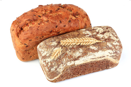 Two freshly baked rye bread isolated closeup on white background.  Stock Photo