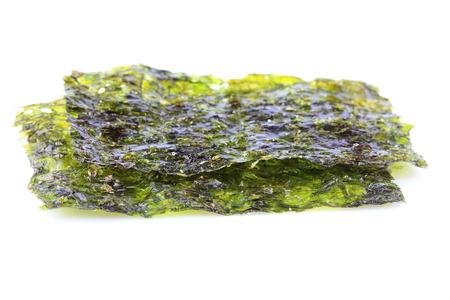 Crispy dried seaweed nori isolated closeup on white background.
