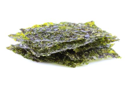 Crispy dried seaweed nori isolated on white background. Stock Photo