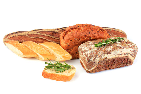 Composition assorted bread with sprig rosemary isolated on a white background.