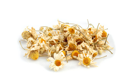 Dried chamomile flowers isolated on white background.