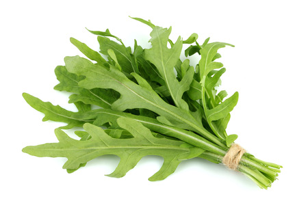 Bunch of arugula herbs isolated on white background.